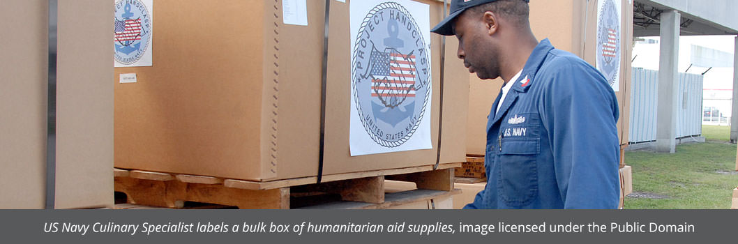 Gaylord box or bulk box being labeled by Navy specialist for humanitarian aid